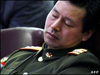 Chinese army delegate sleeps during a session of the National People's Congress