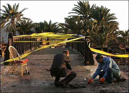 Investigators collect evidence at the scene of the bombings in Dahab
