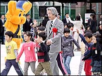 Japanese Prime Minister Junichiro Koizumi and a group of children