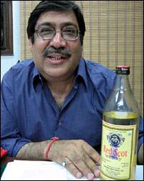 Pravin Anand with a bottle of Red Scot whisky