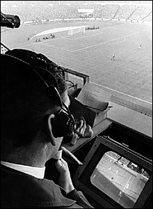 Kenneth Wolstenholme commentates on England's 4-2 victory over West Germany in the 1966 World Cup final at Wembley
