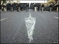 Riot police block a road in Athens on Monday