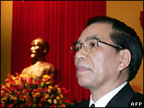 Newly re-elected Vietnamese communist party Secretary General Nong Duc Manh, as he delivers the closing speech, with a bust of Ho Chi Minh in the background.