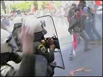 TV grab of police and protesters clashing in Athens