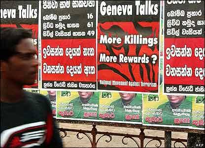 Colombo residents near peace talks poster