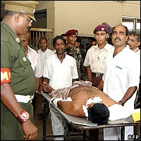 A Sri Lankan soldier is taken to an eye hospital after a blast in Colombo