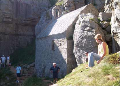 Craig Hughes' wife Carolyn, and his parents at St Govans Church whilst on vacation in Wales