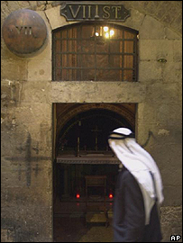 Palestinian walks past the seventh station of the cross on the Via Dolorosa in Jerusalem