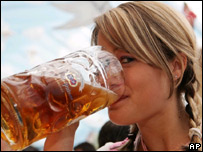 Woman drinking a beer at last autumn's Oktoberfest in Munich