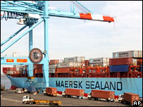 A container ship being loaded at port