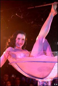 Stripper Dita Von Teese performs at film premiere