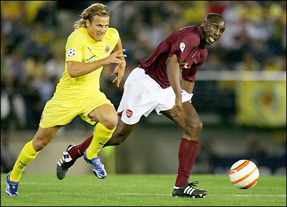 Sol Campbell chases the ball with Diego Forlan