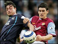 Albert Riera (l) challenges Aston Vila's Gareth Barry