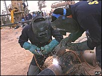 Workmen fixing an oil pipeline in Iraq
