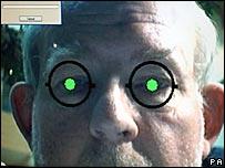 Mr Clarke testing an iris scanner