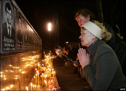 Residents pay their respects at the Chernobyl memorial in Slavutych