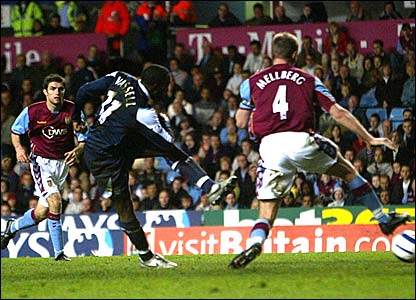 Darius Vassell scores for Man City at Villa Park