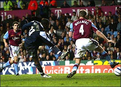 Darius Vassell scores for Man City at Villa Park