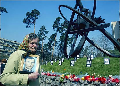 Praskoviya Nezhyvova holds a portrait of her son Viktor, who died after Chernobyl clean-up 