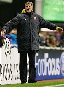 Arsene Wenger watches his side play Ajax