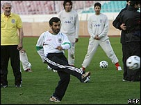 President Mahmoud Ahmadinejad, wearing Iran's football strip, practises with the national team