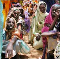 Women waiting for food to be distributed in Darfur in 2004