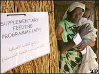 A woman and child leave a clinic in Darfur in 2004