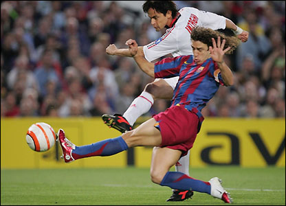 Filippo Inzaghi is tackled by Carles Puyo