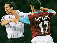 Liverpool's Luis Garcia (left) and West Ham's Hayden Mullins clash at Upton Park and could miss the FA Cup final