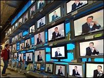 TVs in shop (Image: AP)