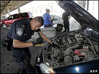 US Customs and Border Protection officer inspects a car at El Paso, Texas