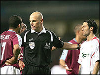 Referee Howard Webb sends off Hayden Mullins (left) and Luis Garcia