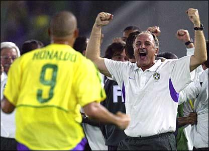 Ronaldo and Luiz Felipe Scolari celebrate winning the World Cup