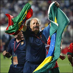 Scolari clutches flags of Brazil and Portugal after beating England on penalties in the quarter-final of Euro 2004