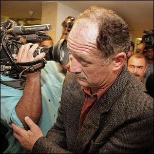 Scolari is confronted by the press after resigning as coach of Brazil