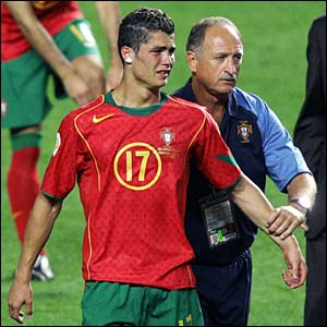 Scolari consoles Christiano Ronaldo after Portugal lose to Greece in the final of Euro 2004