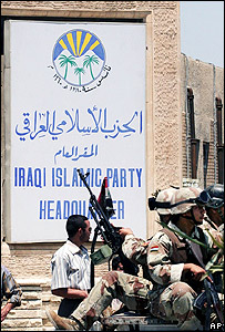 Soldiers guard the Iraqi Islamic Party headquarters