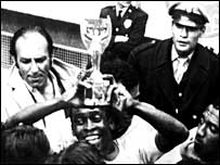 Pele gets his hands on the World Cup