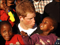 Harry with six-year-old Aids orphan Mutsu Potsane