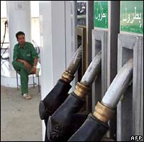 An Afghan fuel station employee waits for customers at a service station in the Shomali plain, 20 kms north of Kabul