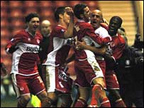 Massimo Maccarone celebrates with his Boro teammates
