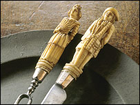 A knife and fork carved with the figures of a man and a woman