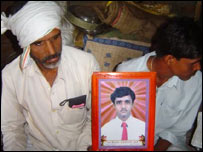 A photo of Kailash Jhade, held by his family