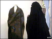 A Saudi woman walks past a shop selling women's clothing in Jeddah, Saudi Arabia (Photo: Mahmoud Mahmoud/AFP/Getty Images)