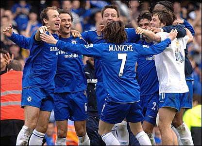 The Chelsea players celebrate at the final whistle