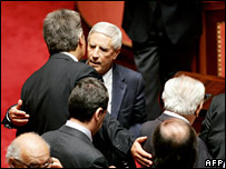 Franco Marini (c) embraced by coalition members after casting his vote