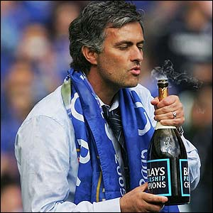 Jose Mourinho celebrates with a bottle of champagne