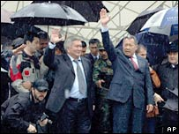Kyrgyz President Kurmanbek Bakiev (right) and Prime Minister Felix Kulov address the rally