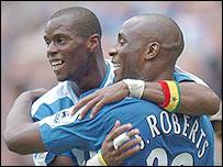 Henri Camara celebrates with Jason Roberts