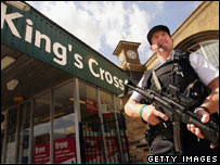 Armed policeman on patrol outside King's Cross station in London